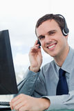 Portrait of an office worker using a headset Stock Photography