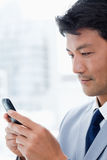 Portrait of an office worker using his mobile phone Stock Photo