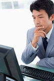 Portrait of an office worker using a monitor Stock Image