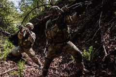 Portrait of officers on reconnaissance. With machine guns royalty free stock image