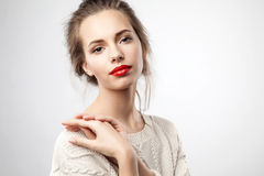 Portrait ofwoman with red lips. Portrait of a blonde young pretty woman with natural make-up and red lips Royalty Free Stock Images