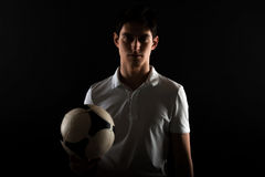 Portrait og young man football player with ball in hand Stock Images