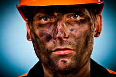 Portrait oil industry worker. Oil industry worker on blue background Stock Photos
