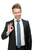 Portrait of okay gesturing businessman Stock Photography