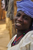 Portrait of old african  women in village. Old african women in village chewing stick and wearing blue turban, traditional women, village Niger Royalty Free Stock Photos