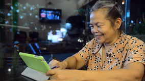 Portrait of old asian people, happy senior asia womam. Looking at tablet and smiling stock video