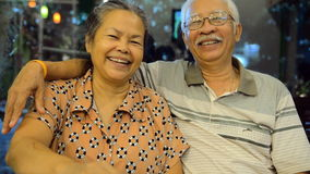 Portrait of old asian people, happy senior asian man and woman. With white hair looking at camera and smiling. Sequence stock video