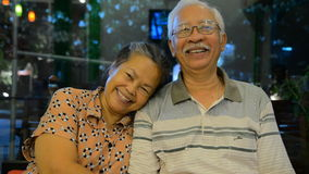 Portrait of old asian people, happy senior asian man and woman. With white hair looking at camera and smiling. Sequence stock video footage
