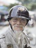 Portrait of old biker. Hoi An, Vietnam - Dec 28, 2016: Portrait of an old biker in Hoi An who keeps his goatee like his hero Ho Chi Minh Stock Photos