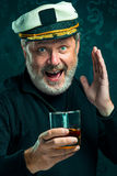 Portrait of old captain or sailor man in black sweater Stock Image