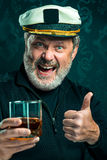Portrait of old captain or sailor man in black sweater Royalty Free Stock Images