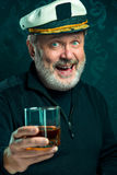 Portrait of old captain or sailor man in black sweater Stock Images