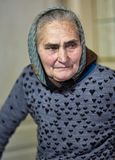 Old farmer woman indoor Royalty Free Stock Images