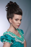 Portrait of old fashioned girl in cyan dress Royalty Free Stock Image