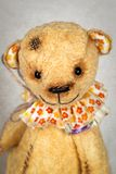 Portrait of old fashioned teddy bear. Handmade stock photography
