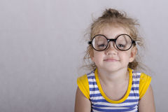 Portrait-old girl in funny glasses Stock Images