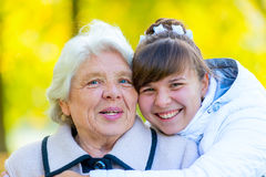 Portrait of an old grandmother and a young granddaughter royalty free stock image