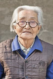 Portrait of an old gray Chinese lady, Beijing, China Royalty Free Stock Photo