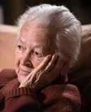 Portrait of old gray-haired sad woman Stock Photos