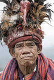 Portrait old ifugao man in national dress next to rice terraces. Banaue, Philippines Royalty Free Stock Photo