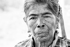 Portrait of old indigenous Guarani woman. Pantanal, PARAGUAY in August 2015: Black and white portrait of an old indigenous woman in northern Paraguay. The the Royalty Free Stock Photo