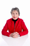 Portrait of old lady with grey hair in red jacket isolated on wh Stock Photo