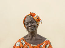 Portrait of an old lady wearing a traditional headdress Royalty Free Stock Photography