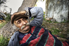 Portrait of an old lebanese man taking a nap in na Stock Photos