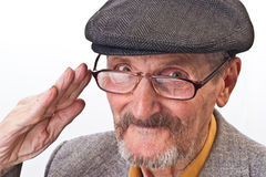Portrait of the old man. The old man with glasses and peaked cap Royalty Free Stock Photo