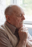 Portrait of an old man. Thinking royalty free stock photography