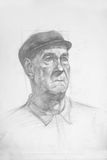 Portrait of old of the man in a cap Stock Image