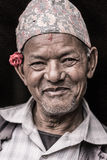 Portrait of an old man with a flower Stock Photo