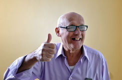 Portrait of an old man. With funny face stock photography