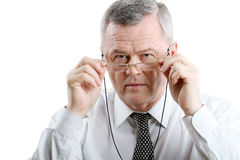 Portrait of old man with glasses Stock Photos