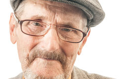 Portrait of an old man. With glasses and a cap Stock Images