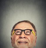 Portrait of Old Man with glasses looking up Royalty Free Stock Photography