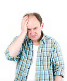 Portrait of old man having a headache. On white background stock image