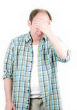 Portrait of old man having a headache. On white background royalty free stock image