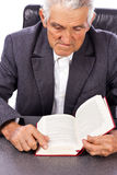 Portrait of an old man reading a book Royalty Free Stock Photo