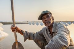 Portrait old man salt farmer in the coastal at Phetchaburi provinces stock photo