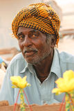 Portrait - Old man selling corn at Clifton beach, Karachi royalty free stock image