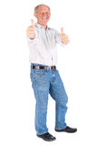Portrait of old man showing thumbs up Stock Image