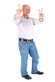 Portrait of old man showing victory sign Royalty Free Stock Images