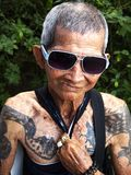 Portrait of an old man with tattoo Stock Photography