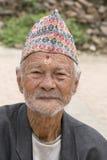 Portrait old man in traditional dress in street Kathmandu, Nepal Royalty Free Stock Photo