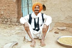 Portrait of old man in turban. Mandu, India. Portrait of old man on the doorstep of his dwelling in Mandu Royalty Free Stock Photo
