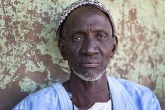 Portrait of an old man in the village of Mandina Mandinga in the Gabu Region. Gabu Region, Republic of Guinea-Bissau - February 7, 2018: Portrait of an old man stock photo