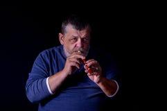 Portrait of old musician. Playing Ukrainian woodwind instrument sopilka Royalty Free Stock Image