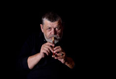 Portrait of old musician. Playing Ukrainian woodwind instrument sopilka Stock Images