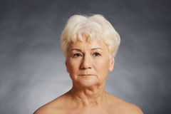 Portrait of an old nude woman. royalty free stock photos